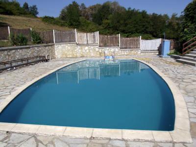 Wooden fence surrounding geometric swimming pool