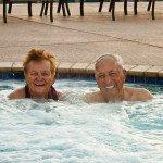 Older couple sitting in an inground hot tub
