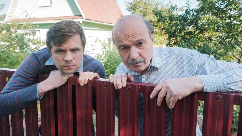 Two nosy neighbors peeking over the pool fence