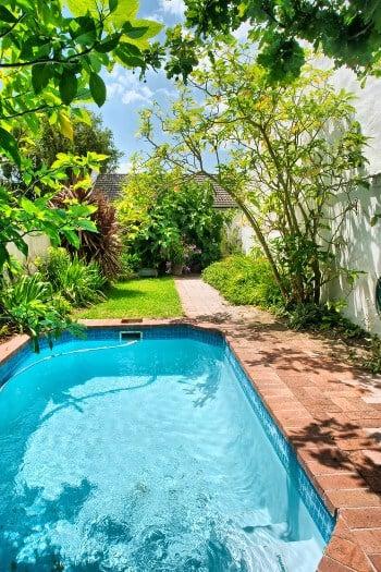 Rectangular inground swimming pool with minimal deck