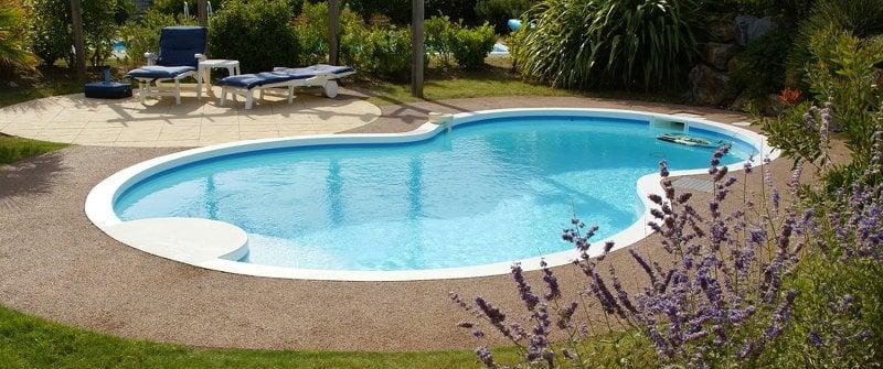 A figure 8 shaped inground swimming pool
