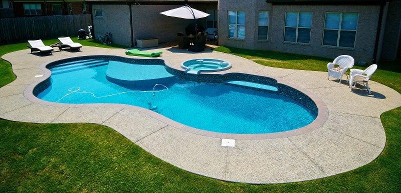 Freeform shaped inground swimming pool