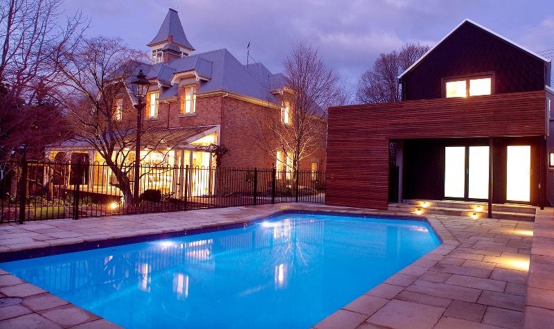 Backyard pool at night