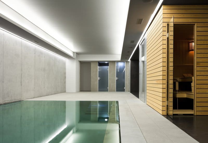 Modern indoor pool with sauna room