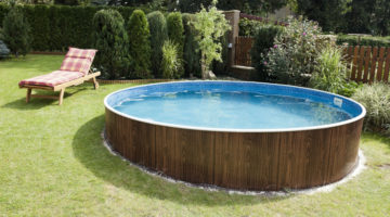 Picture of an above ground pool that's slightly buried