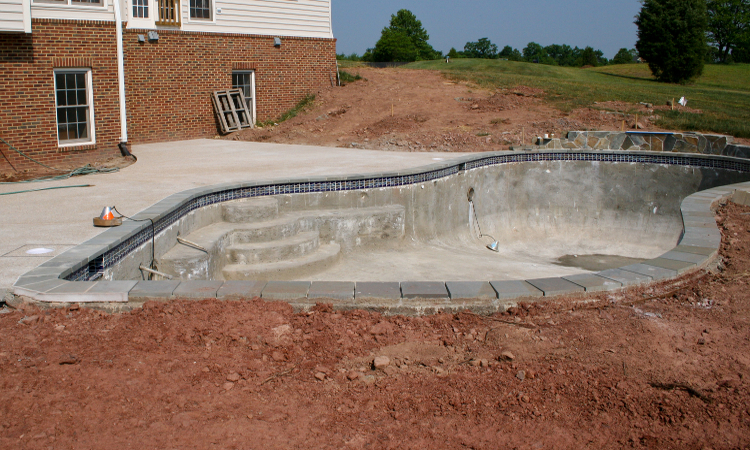 Photo of concrete pool construction illustrating differences between fiberglass and concrete pools