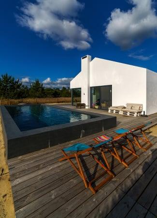 Semi inground swimming pool with deck